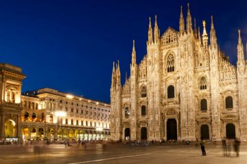 Milan Cathedral at night, panorama including Vittorio Emmanuele II gallery.